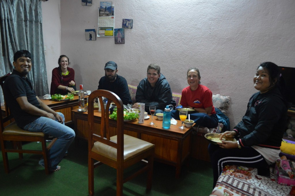 Eating dinner in trekking guide Ang Dendi Sherpa's home, with his wife Mingma and trekkers Leo, Kore and Teresa