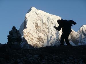 Monte & a chorten as silhouettes on Cholatse Peak