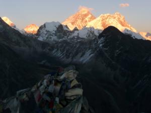 Everest, center, from Gokyo Ri . . . high winds and steep slopes combine to keep Everest relatively snow-free