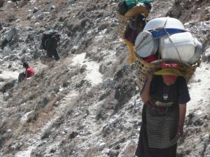 Heavily laden porters having just finished crossing the Ngozumpa Glacier
