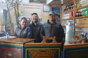 The friendly lodgekeepers of the Kamal Lodge in Namche Bazaar . . . Kamal, on the right is the father with his son and daughter-in-law