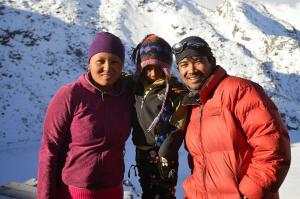 Dendi Sherpa with the innkeeper of Gosaikunda and her son