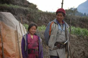 Lodge proprietors near Goljung . . . the  big knife is called a khukuri and is typically kept in the belt of Tamang men.