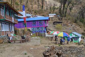 Tatopani has a large hot spring pool, colorful lodges and friendly people