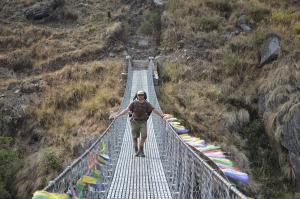 Jerry on the long bridge over the Trisuli River that signifies the thankful end to a three hour downhill