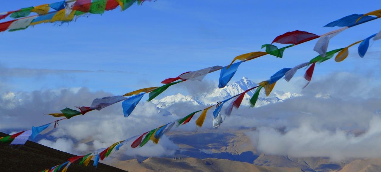 Mt Everest as seen through prayer flags from the Pang La, Tibet