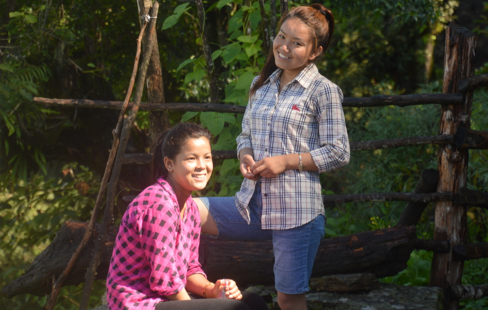 Smiling Sherpa girls are porters for students