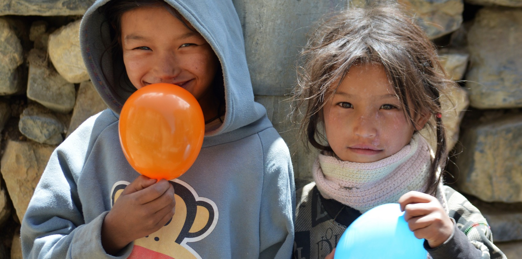Kids with balloons in Jhong, Nepal