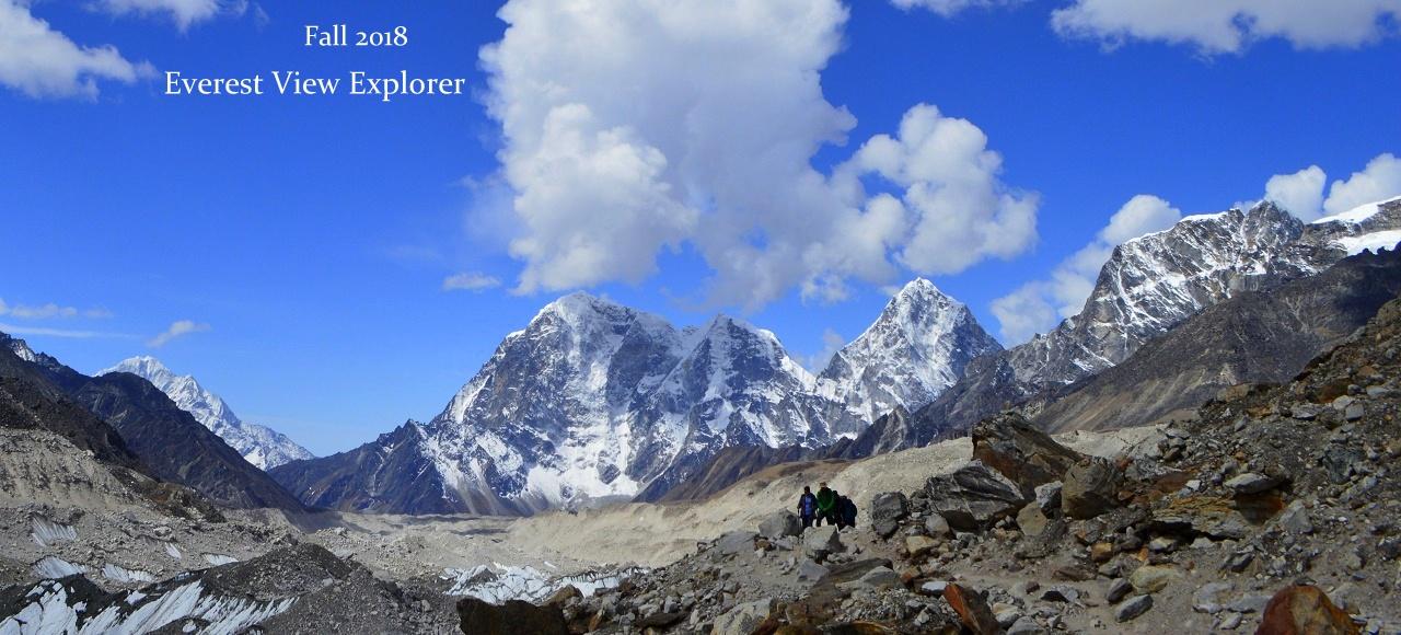 Trekking from Gorak Shep to Everest Base Camp under brilliant blue skies