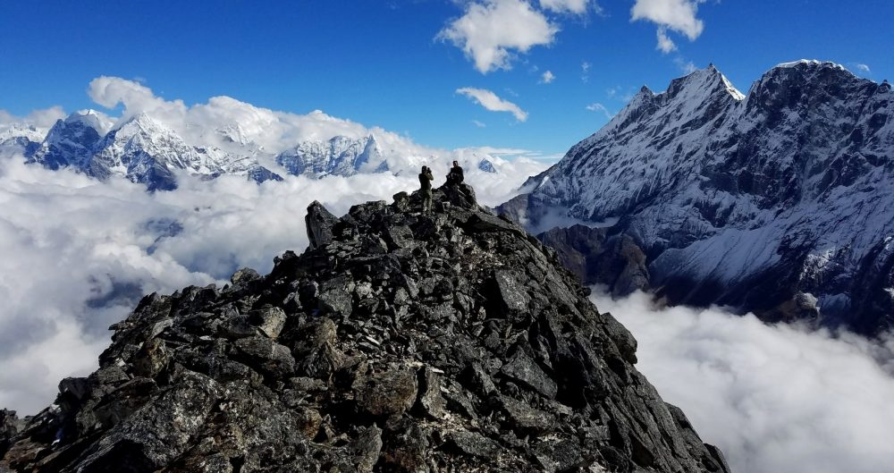 Two Sherpas on the summit of Sumdur Peak, a pile of rocks high above Thame, Nepal