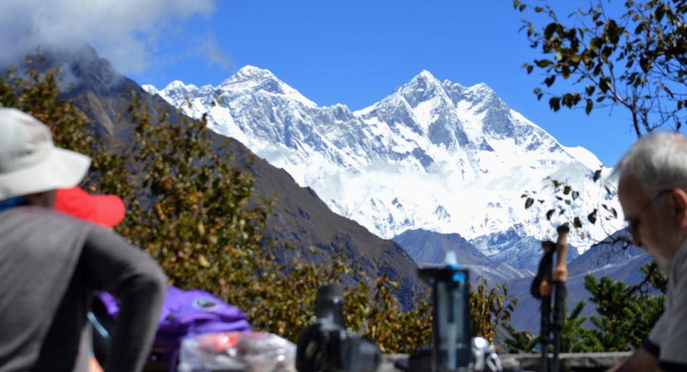Trekkers in the Khumbu Region of Nepal with Everest behind the Lhotse-Nuptse Wall