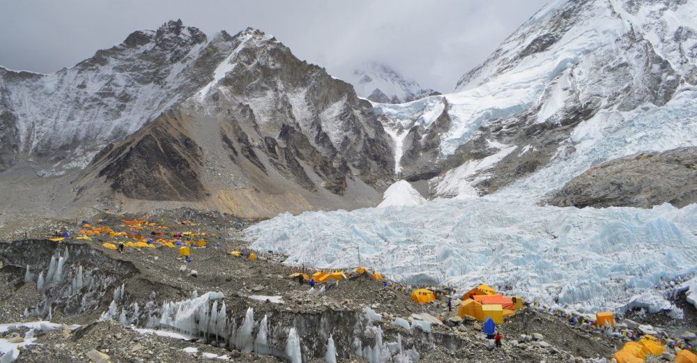Everest Base Camp with many tents on a glacier near Khumbu Icefall