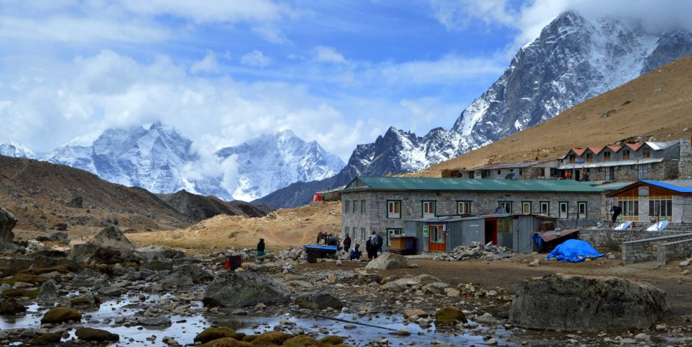 The village of Lobuche in the Khumbu Region of Nepal with mountains and a small river