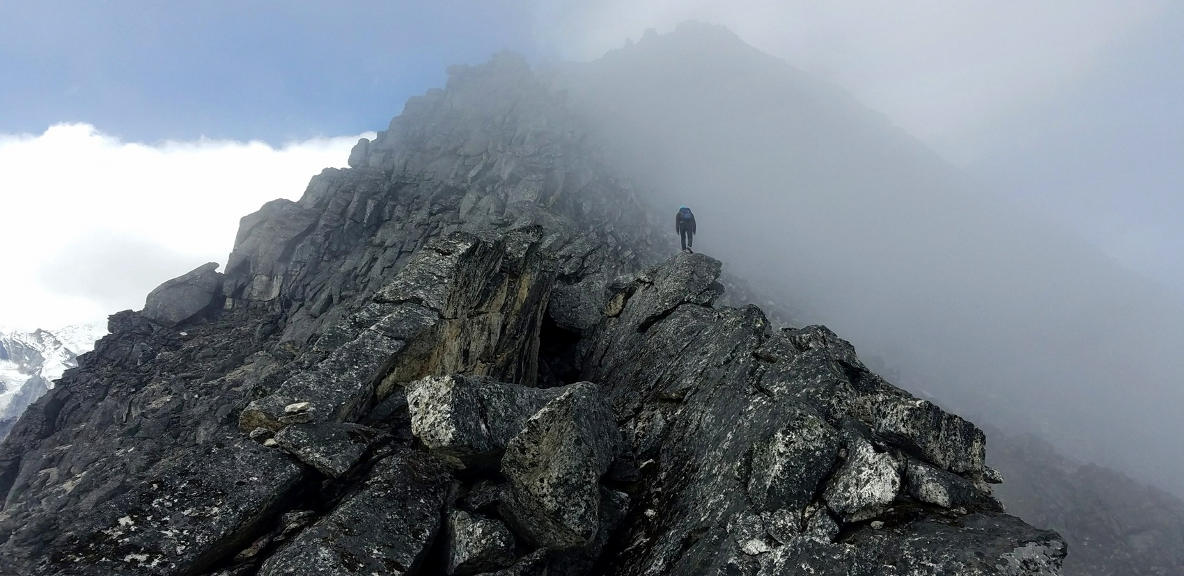A Sherpa leads the way up through boulders to the summit of Sumdur Peak