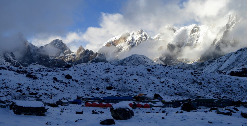 The Himalaya village of Dzonglha with snow and the mountains around the Cho La Pass
