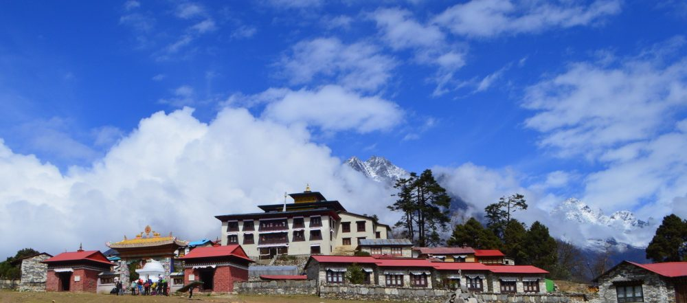 The Tengboche Monastery on the trek to Everest Base Camp under blue skies and puffy clouds