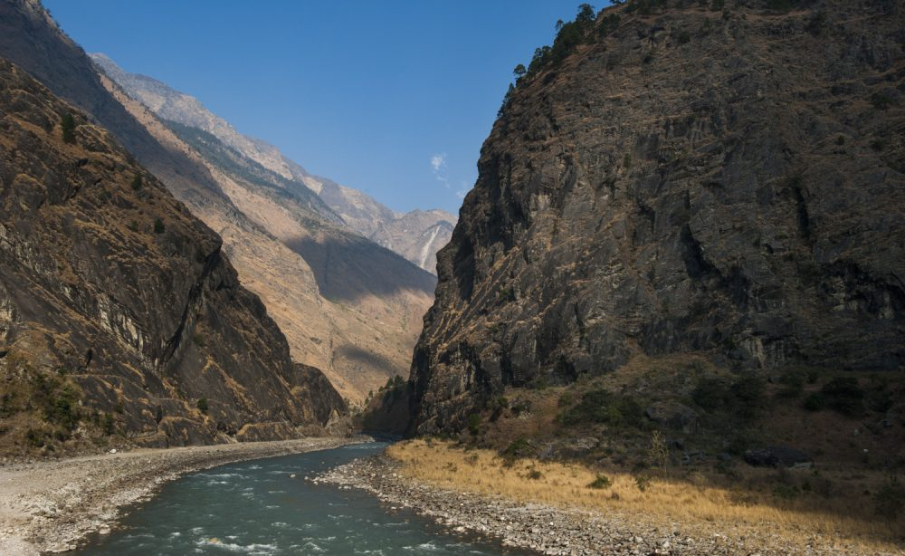 The Budhi Gandak River rolls down through a steep, rocky gorge in the Nepal Himalaya