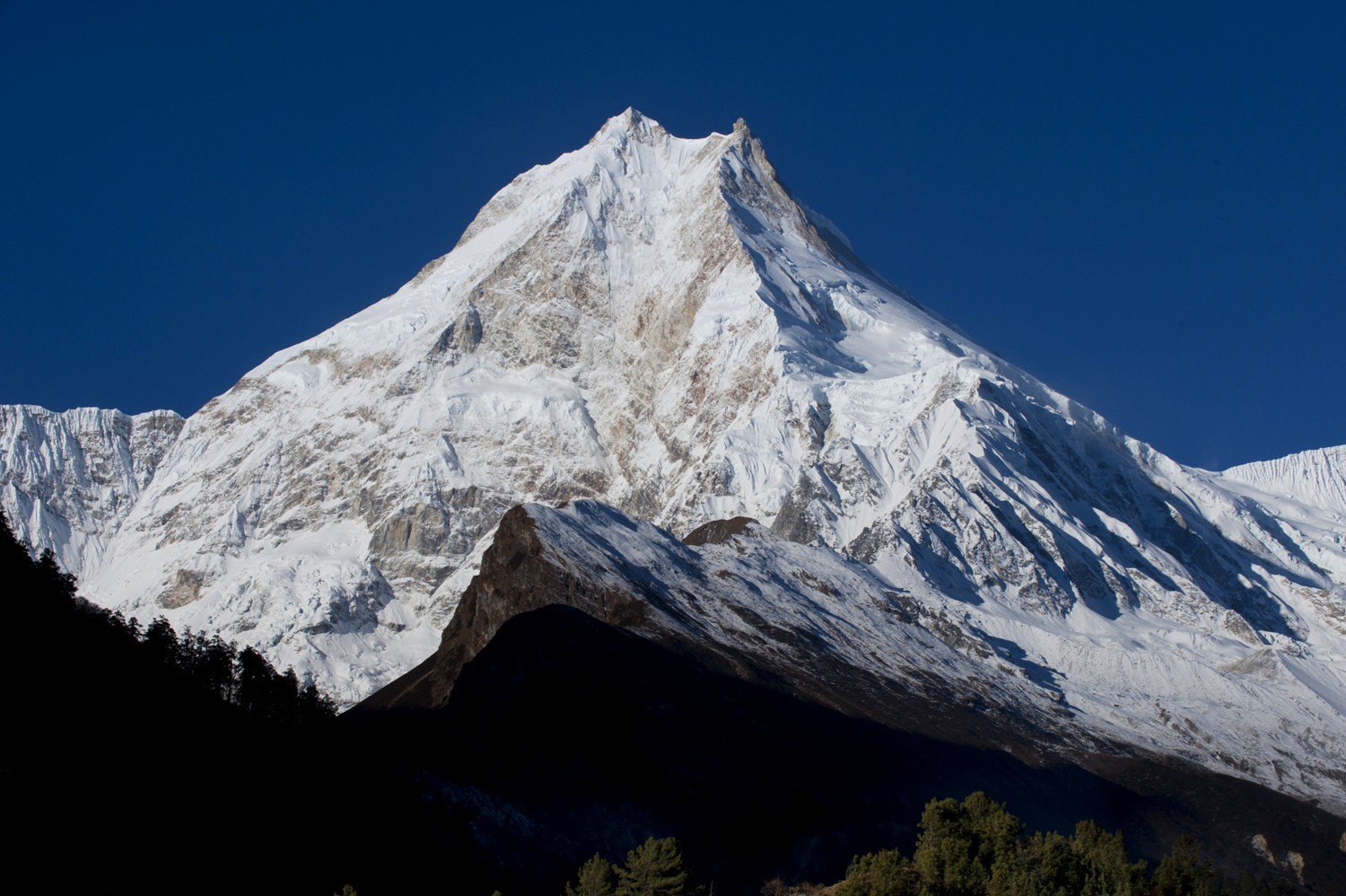 Mt Manaslu and its double summits tower over the surrounding valley on a clear day