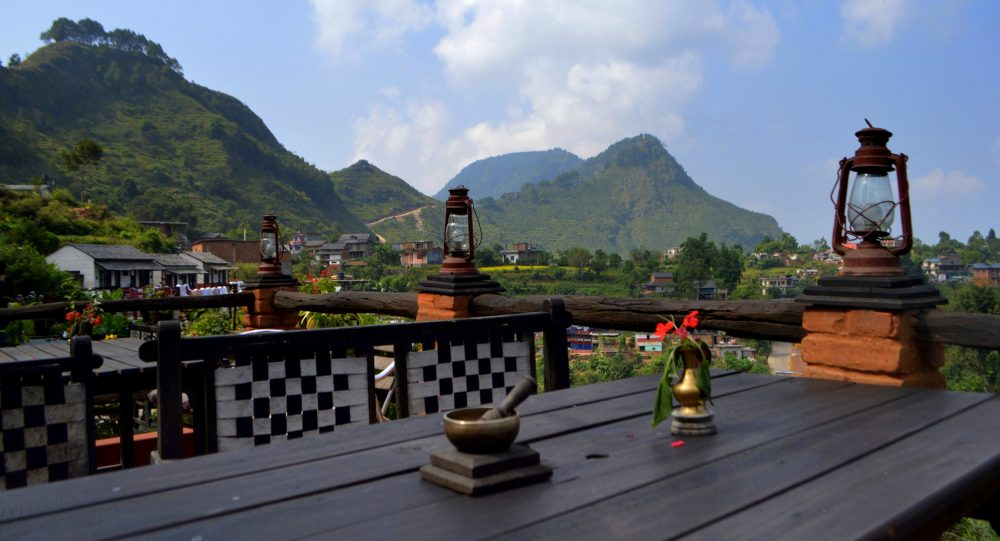 The village of Bandipur with balconies overlooking green mountains and the Himalaya