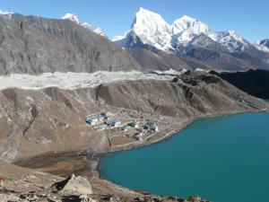 """Gokyo Lake & Gokyo Village w/ Cholatse and Tawache peaks behind - from Gokyo Ri . . . the """"dirty"""" Ngozumpa Glacier, behind Gokyo Village, tumbles off of the 8,000 meter Cho Oyu and is the largest glacier in Nepal"""