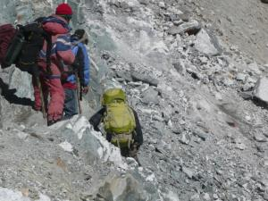"""The """"trail"""" from the Cho La summit to the glacier path below . . .  in 2000, the glacier met the summit and you could walk directly onto the glacier. . . now however, clammering down to the glacier is a necessity because the glacier has lost 20 ft. of thickness in the past ten years"""