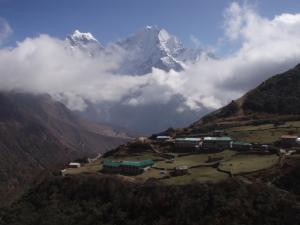 Dole with the peaks of Kangtega, left, and Tham Serku, right . . . the stone walls in Dole try to keep the unruly yaks in their place
