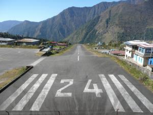 The steep runway at the Lukla Airport has a 12% gradient . . . to put this in perspective, pedaling a bicycle up the runway would be very difficult!  The runway was paved only about ten years ago.