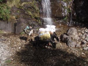 Water break under a tall waterfall near Bengkar