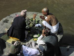 Hindu priests performing cremation rituals at Pashupatinath, Hinduism's most holy site in Nepal