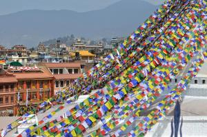 A mountain of prayer flags blowing in the wind at Boudha Stupa