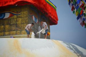 Whitewashing the dome of Boudha Stupa