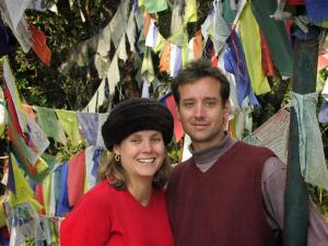 Jerry with his wife, Mary Ellen, amongst the prayer flags at Nagi Gompa