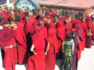 Tibetan Buddhist monks at the Boudha Stupa to celebrate Losar