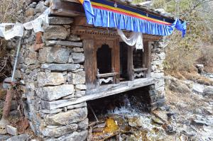 Taking a look inside this house, there's a prayer wheel powered by the waterfall, so it spins constantly sending out blessings to the world