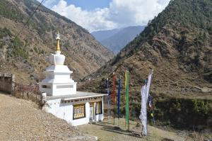 Small Buddhist Stupa and prayer flags in Syabru Besi