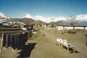 The trail leading into the village of Jomosom with Dhaulagiri lurking behind ~ Jomosom boasts an airport and luxury hotel