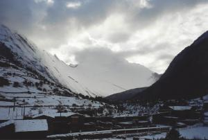 The village of Pisang and it's 4,000 ft high slab of ramped rock behind, covered in snow