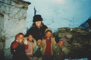 Mary Ellen with the kids of Ghyaru and a wall of Annapurna ice in the background